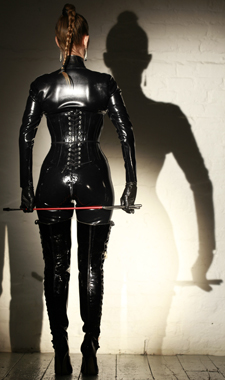Caning Mistress in Rubber Catsuit